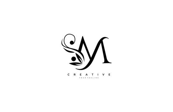 Flourishes letter M luxury beauty monogram logo