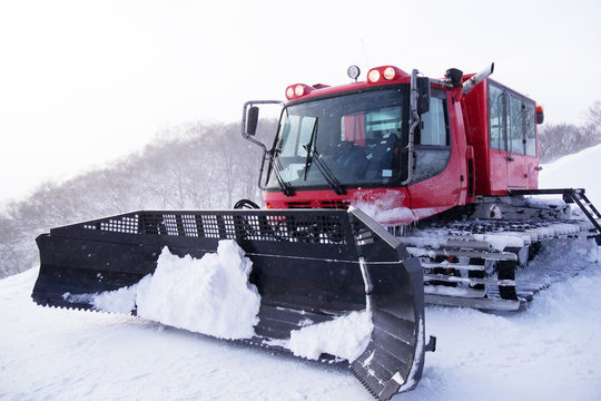 FEB 18, 2018 IWATE JAPAN : Red snowcat in winter mountains A red snow tucker covered with snow in Iwate Japan.