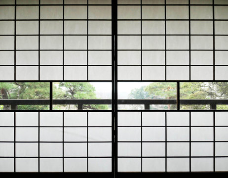 Shoji, Traditional Japanese sliding door made of rise paper closed in front of garden