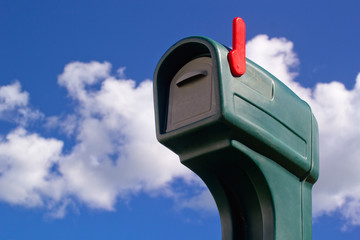 Green mailbox and blue sky