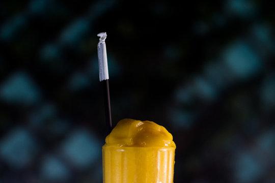 Closeup shot of a yellow smoothie