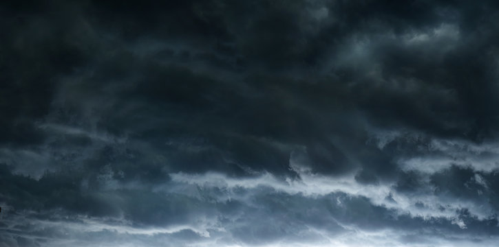 The typhoon is born, a tornado in a stormy dark sky with black clouds and a strong wind. Concept on the theme of weather, natural disasters, tornadoes, typhoons, tornadoes, thunderstorm.
