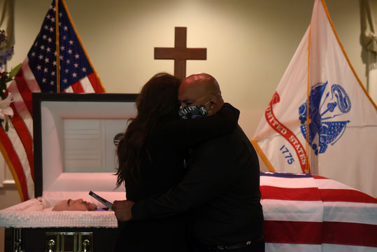 Mourners attend a funeral for a Texas man who died of COVID-19