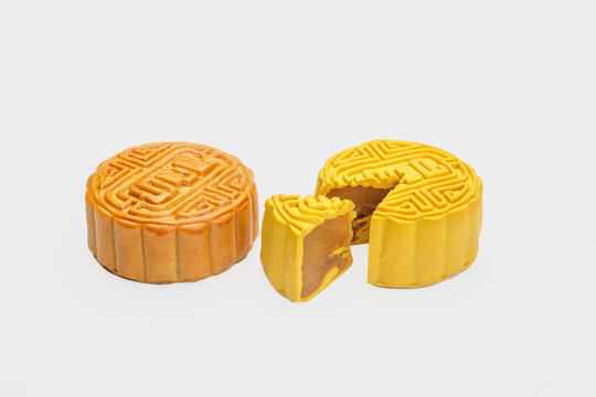 Traditional mooncake with durian and nuts filling on white background