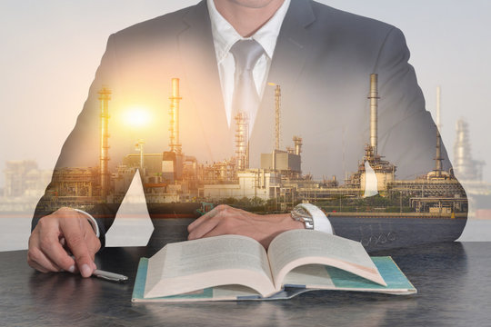 Double exposure of businessman meeting room to open the book, oil fuel, Electric generating factory, plant and sunset as business, meeting, Learning, industrial and energy concept.