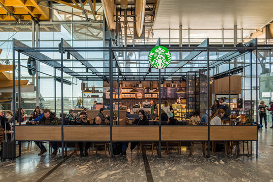 Starbucks coffee with customers relaxation of located branch inside at Oslo airport