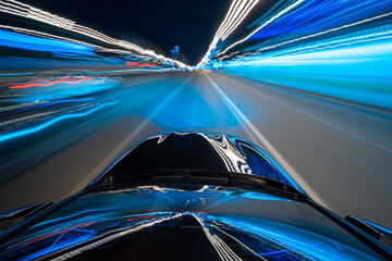 View from roof of a Black Car moving in a night city, Blured road with lights with car on high speed. Concept rapid rhythm of a modern city.