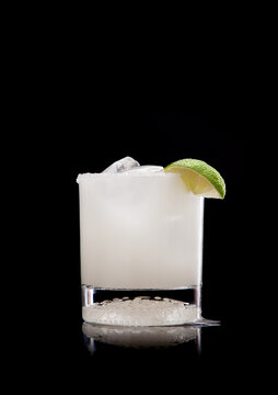 Scratch margarita in old fashioned glass on black background