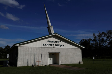 The steeple of the Starlight Baptist Church leans from wind damage after Hurricane Laura passed near Eunice, Louisiana