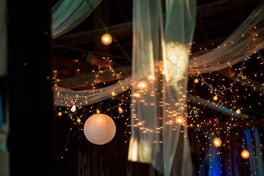 Wedding reception lighting at a barn wedding in the summer