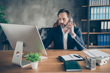 Portrait of his he nice attractive focused busy man insurance sales expert consulting client investor banking service support account at modern loft industrial work place station indoors