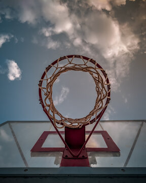 basketball under beautiful summer sunlight with clouds background