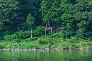 Shiraito Falls with red torii is superb view of Mogami River valley in Yamagata, Japan