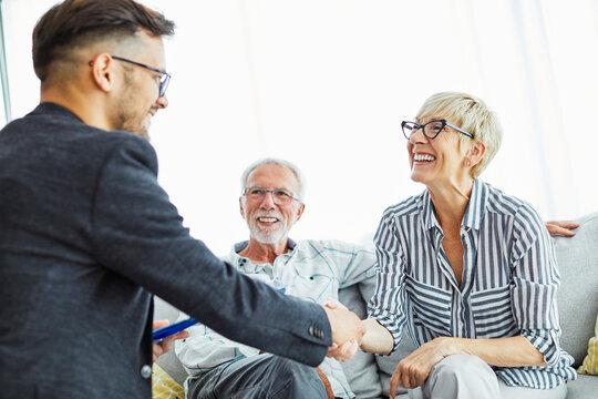 handshake senior couple investment business finance hand agent meeting agreement planning home