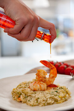 seasoning with shrimp risotto oil