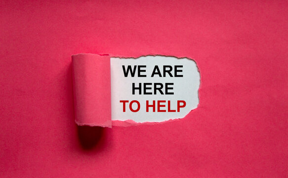 The text 'we are here to help' appearing behind torn pink paper. Business concept. Copy space.