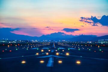 Airfield ground lighting on runway, sunrise time at Hong Kong Airport Fotobehang