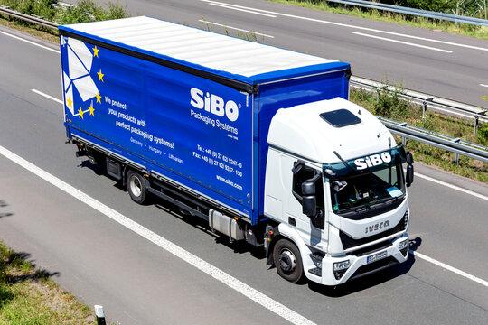 WIEHL, GERMANY - JUNE 26, 2020: SiBO Iveco Eurocargo truck on motorway.