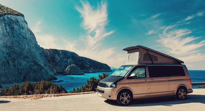 Beautiful summer seascape. ?ar camper near Most Famous Porto Katsiki Beach of sunny day. Scenic Image Ionian Sea. Lefkada, Greece.Travel on car is Lifestyle, conception. Idea of Adventure lifestyle.