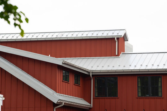 modern standig seam metal roof with roof window, fume hoods snow guard rain gutter