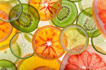 Abstract photo of mix fruit slices, top down