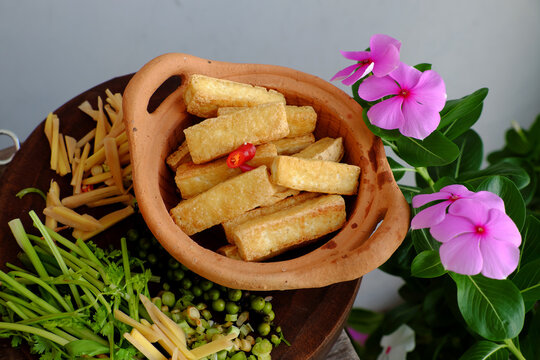 sliced fried tofu with ginger for simple homemade vegan food