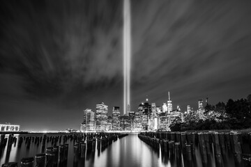 Tribute in Light,911 memorial,New york city skyline with reflection in water at night.