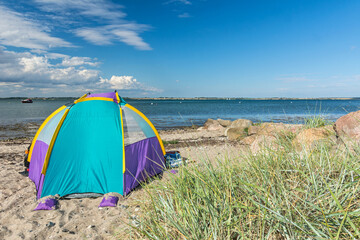 Colourful tent at a beautiful beach at the Baltic Sea in Westerholz in Northern Germany