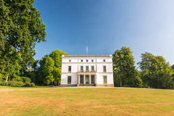 Beautiful historic white mansion (Jenischhaus) in a landscaped park (Jenischpark) in Hamburg, Germany
