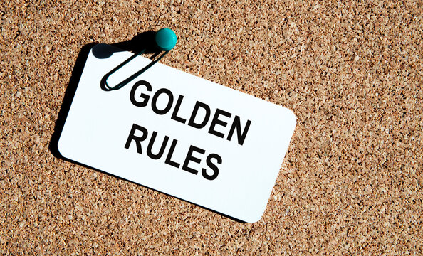 The inscription on the GOLDEN RULES business card. Attached to a corkboard for comments and ideas.
