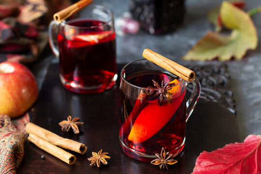 Mulled wine with slice of orange, cinnamon sticks and anise stars, winter drink