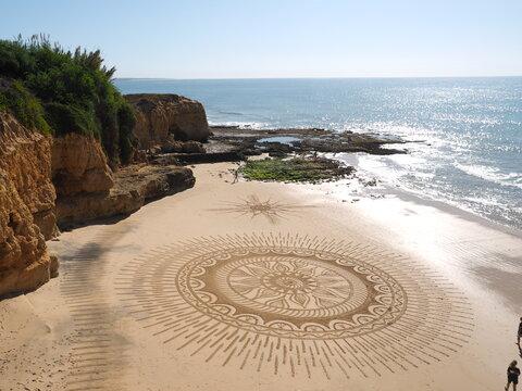 Beautiful beach mandala in Albufeira in Portugal Praia Maria Luisa
