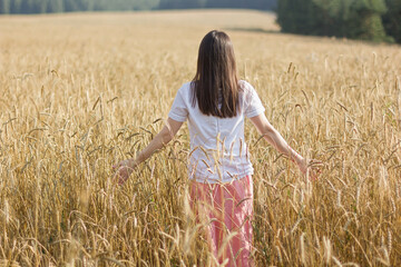 summer holidays, vacation and people concept - happy young woman on cereal field