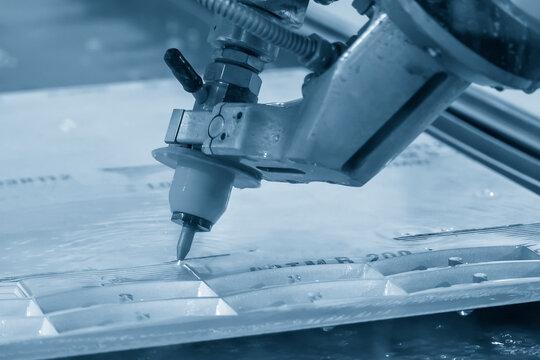 Abrasive multi-axis water-jet machine cutting the aluminium plate. Hi-technology metal cutting by water jet  cutting machine .