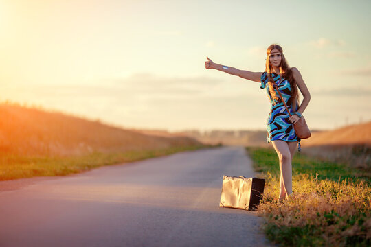The girl hitchhiking