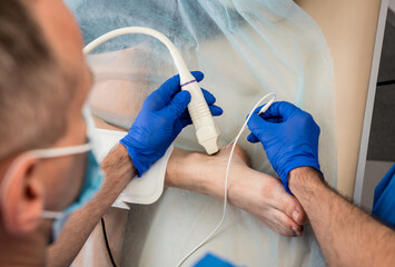 Cardiologist use tubes and ultrasound for radiofrequency catheter ablation.