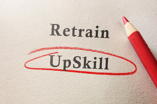 Upskill circled in red pencil below Retrain text on textured paper