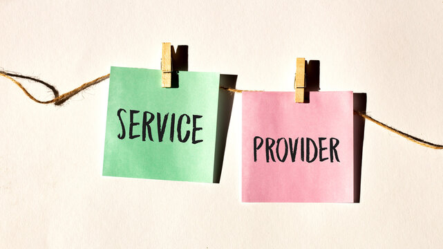 SERVICE PROVIDER text words inscription on yellow sticker note on white wall or table.