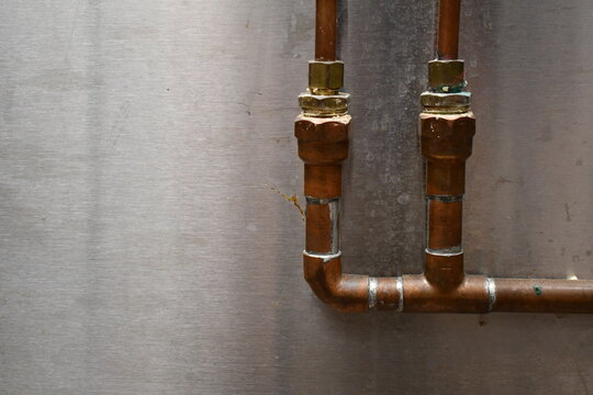 Copper pipes in an industrial kitchen.