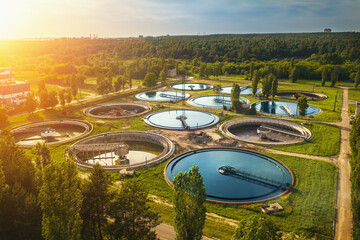Aerial view of modern industrial sewage treatment plant at sunset.