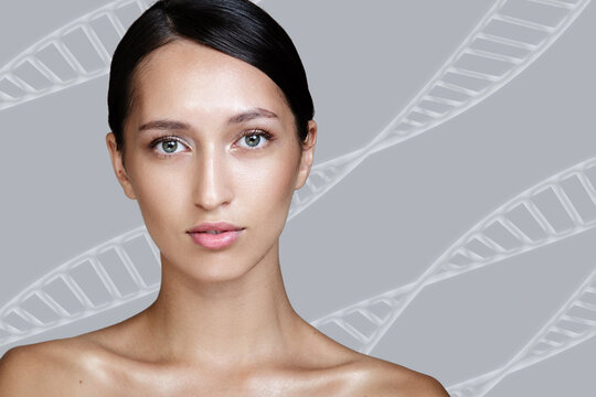 Woman with clean skin. Behind her are dna maleules