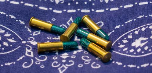 Six old .22 caliber shells on a blue bandana
