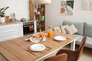 Interior of modern stylish kitchen with dining table