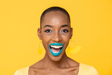 Close up portrait of excited young African American woman with fashionable colorful make up isolated on yellow studio background