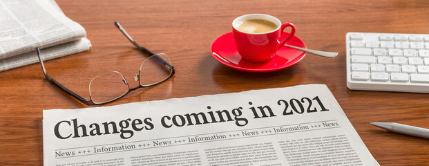 A newspaper on a wooden desk - Changes coming in 2021