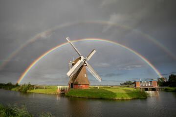big double rainbow over Dutch windmill