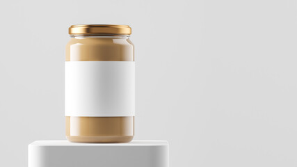 Big tall transparent glass jar with copper metal cap and blank label filled by nut butter on the podium over white background.