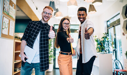Overjoyed multiethnic young team of students having fun in college