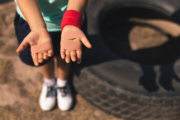 Mid section of boy showing his injured hands at a boot camp