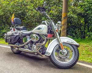 Harley Davidson Heritage Softail motorcycle parked on road.
